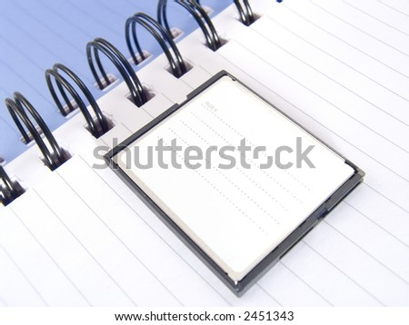 Page of a notebook with compactflash for storage of the information on the camera.  COPYSPACE - a place for accommodation of advertising in a photo.