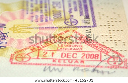 Page of passport with Malaysian customs stamps