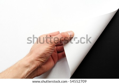 page or blank sheet of paper with hand and copyspace in the corner