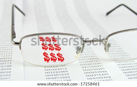 Page with data and glasses on the top. Through glasses symbol of dollar