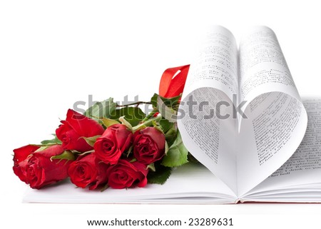 Pages of a book curved into a heart shape and red roses. Valentines day card.