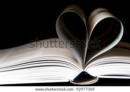 Pages of a book shaped like a heart
