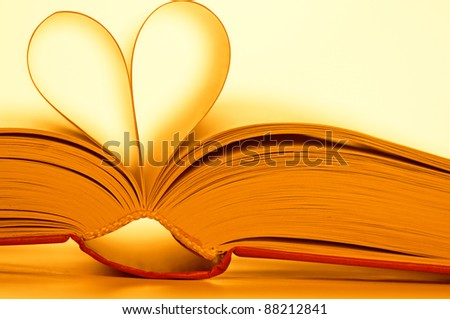 pages of book curved into heart shape