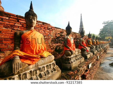 Pagoda and Buddha Statue at Wat Yai Chaimongkol, Ayutthaya, Thailand - stock photo