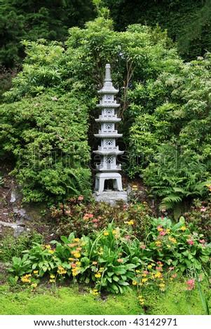 Pagoda sculpture at Japanese style garden - stock photo