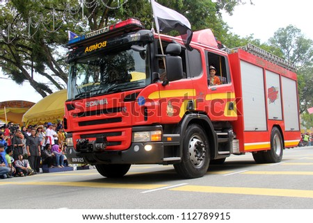PAHANG, MALAYSIA - AUG 31 : Fire Fighter Truck participate National Day, celebrated the 55th anniversary Independence on August 31,2012 in Kuantan, Pahang, Malaysia