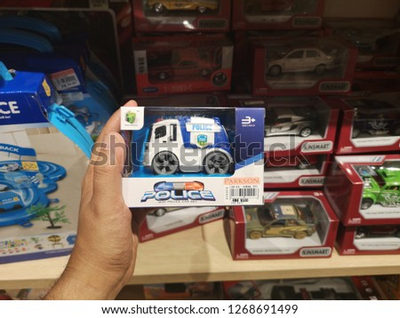 Pahang, Malaysia - 15 December 2018 : Hand hold a set of polis car for sell in hypermarket.   #1268691499