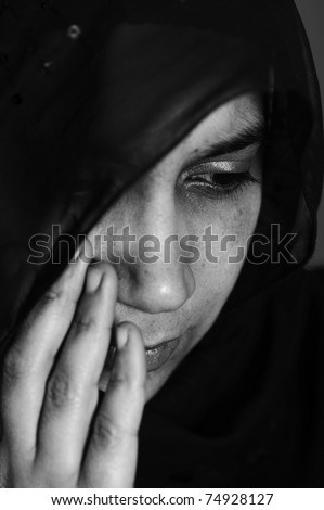 Pain, abused woman crying in dark