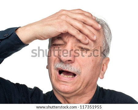 Pain. Elderly man suffering from a headache isolated on white