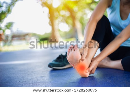 Pain in the foot of the elderly.Symptoms of peripheral neuropathy.Most symptoms are numbness in the fingertips and foot. Stock photo ©