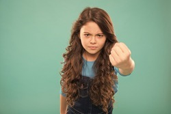 Painful punch. Serious child threatening. Punch you in face. Stop bullying movement. Girl threatening with fist. Threatening physical attack. Aggression concept. Aggressive girl threatening to beat.