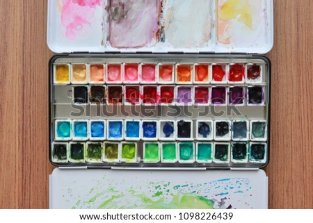 Paint accessories and watercolor on Wooden Table. (workplace mock up,Copy Space,Isolated, White Copy space,Color Copy space, Blank Copy Space, Wood Copy Space.) #1098226439