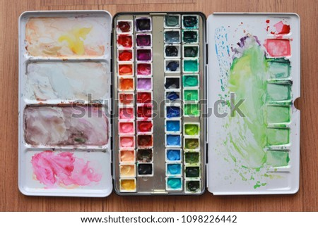 Paint accessories and watercolor on Wooden Table. (workplace mock up,Copy Space,Isolated, White Copy space,Color Copy space, Blank Copy Space, Wood Copy Space.) #1098226442