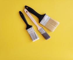 Paint Brush on yellow wall