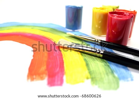Paint brush with rainbow painting and color paint buckets