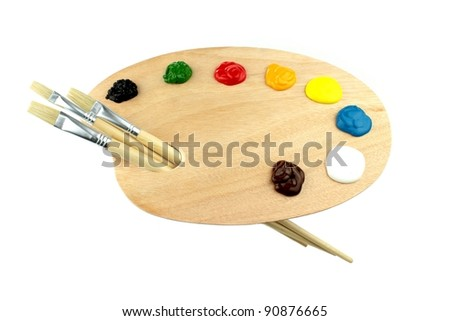 Paint brushes, colors and artist palette