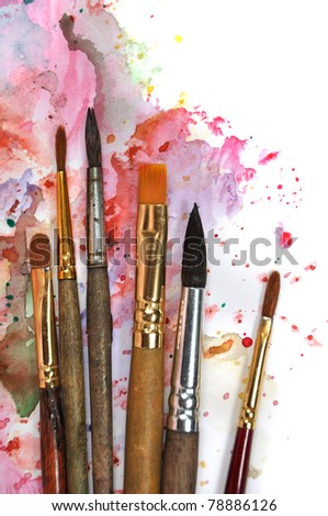 Paint brushes on a watercolor palette