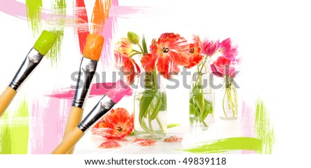 Paint brushes painting  tulips in milk bottles