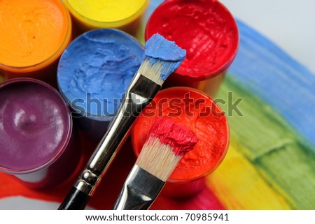 Paint brushes with opened paint buckets