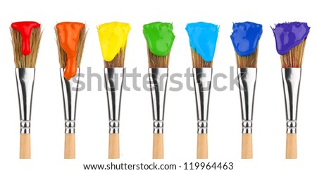 paint brushes with rainbow colors in front of white background