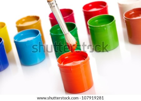 Paint buckets with paintbrush over white background