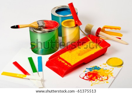 Paint can and brush and roller