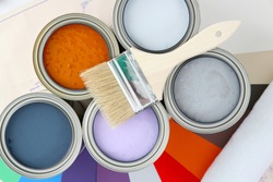 Paint cans ready to be used on white background