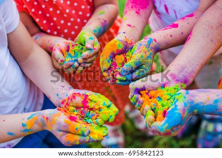 Paint holi on the hands #695842123