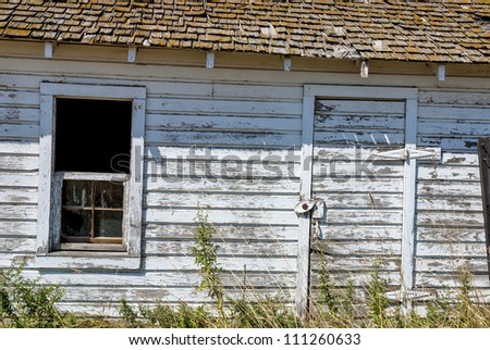 Paint is pealing from the side of an old building - stock photo