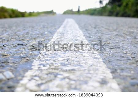 Paint markings on the Mendi - Tambul Highway. Image taken October 12, 2020. Stock photo ©