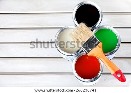 Paint. Paint Cans and Brushes