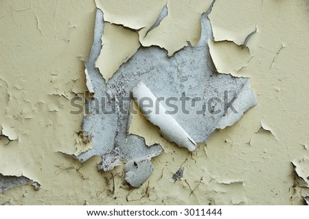 Paint peeling off a grungy wall