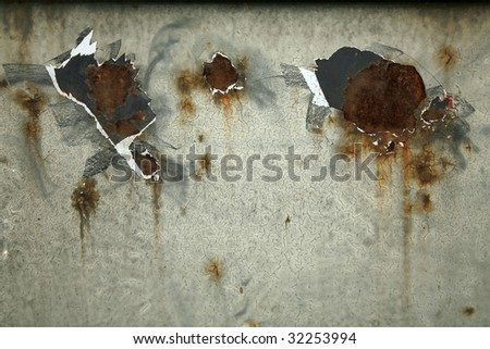 paint peeling off rusted metal