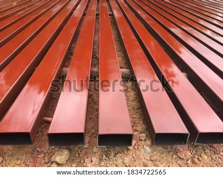 Paint red iron primer to prevent rust. stock photo
