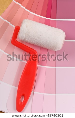 Paint Roller on Pink Paint Color Selection Guide
