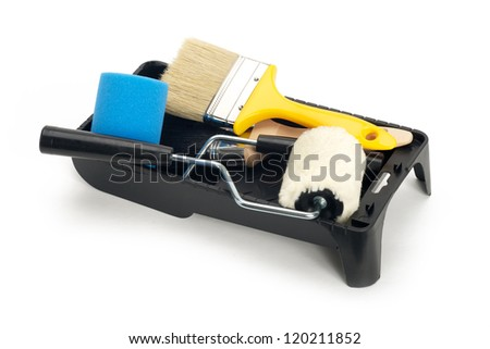 Paint rollers and brush on black tray