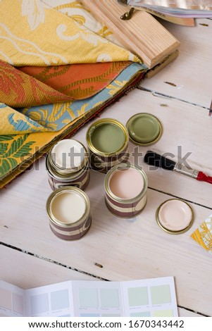 Paint tester pots with color swatches and fabric samples