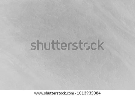 Paint (50%), texture (50%). Texture of the painted surface of a smooth rough wall. Relief plane. Balanced gray color. Light reflex. White Design Background. Artistic plaster. Rastered image. #1013935084