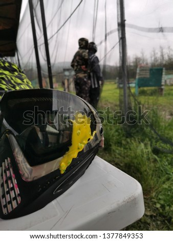 Paintball mask hit with yellow paint ball #1377849353