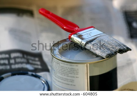 paintbrush and can of paint
