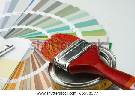 Paintbrush and colorful paint