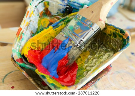 Paintbrush and Colors in a Atelier in Hamburg Altona. Close-up in the studio. Tools to mix colors are available. Charcoal, pencils, acrylic colors and paintbrushes are provided to start painting.
