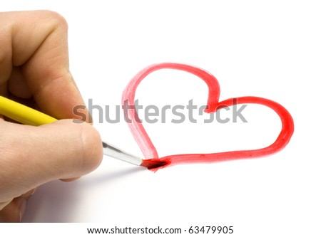 Paintbrush in hand in the man drawn heart