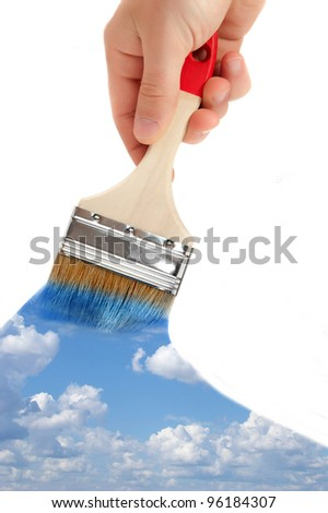 paintbrush in hand paints the sky