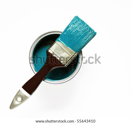 paintbrush on turquoise paint can