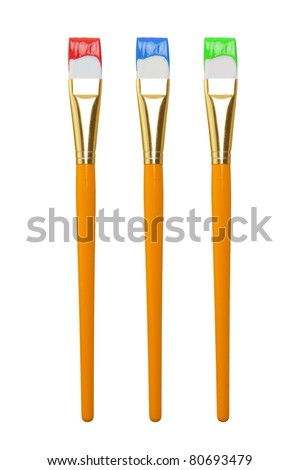 Paintbrush with Paint in Three Colors Isolated on a White Background