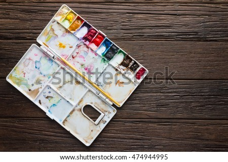 paintbrush with palette color on wooden background #474944995