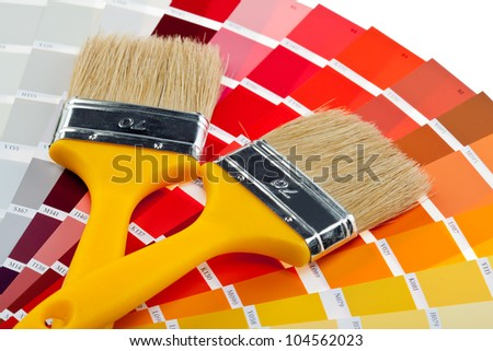 Paintbrushes and color samples for interior and exterior decoration works