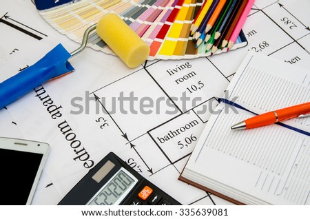 Paintbrushes and colorful paint samples on house plan  with pencil, notebook, tea as background