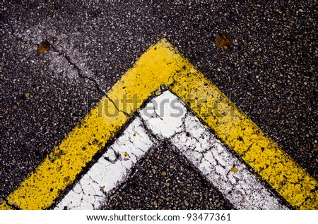 painted asphalt background with white and yellow lines